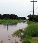 Floods in Bolivia point to future hunger problems.