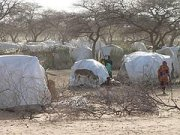 United Nations sounds humanitarian disaster warning in Darfur; ministry hunkers down.
