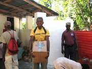 Haiti emergency stockpiles mocked by cargo on the docks
