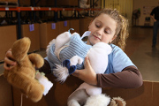 10-year-old holds stuffed animal drive for Haitian children