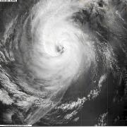 Floods cause damage; hurricanes threaten more devastation