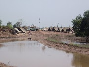 Floods threaten more further south