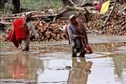 Aid comes slowly to many flood survivors