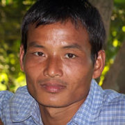 A ministry team celebrates the dedication of another New Testament for a people group in Northeast India