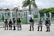 Haiti president to leave in May, riot ensues