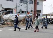Triple threat hangs over response teams in Japan