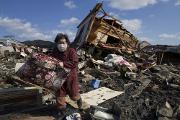 Quake survivors return home, fall into limbo