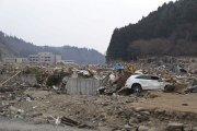 Japanese families still rummaging through rubble
