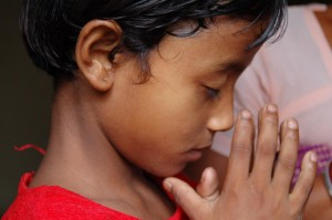 MNI_india kid praying 11-29-12