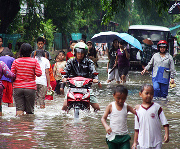Jakarta floods; more water on the way.