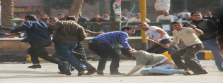 Egypt - Plainclothes police clash with protestors - Tahrir Square (315x118)