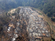 Flames fall on refugee camp housing mostly women, children, and elderly
