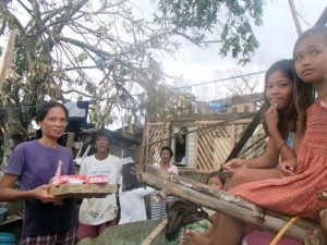 Carlota Ursaig, 45-years-old, was thankful to be reunited with her 6 children after a tree landed on the house they had been taking shelter in. They gladly received food that an OM team had to spare. (Image, caption courtesy OM)
