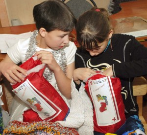 "(Photo courtesy SOAR International Ministries) Kids receive their ""Stuff a Stocking"" gifts."