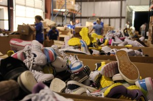 Unloading shoes donated by church in Texas (Photo by Buckner International)