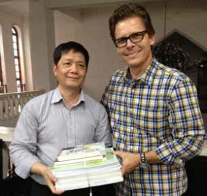 Handing out Pastor Packs (set of theological study books) to those who attend our PTS is always a highlight for China Partner. (Image, caption courtesy China Partner)