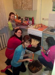 Peeling, dicing, cutting and baking. Wonderful team work! (Image, caption courtesy Orphan Outreach)