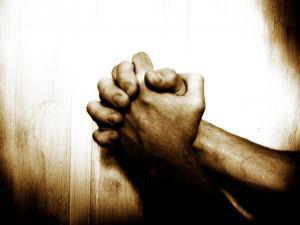 Praying hands. Sudanese Christians need prayer.