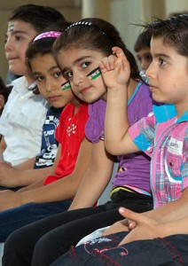 A group of Syrian refugee children who are listening to Jordanian Christians share Bible stories. (Image, caption courtesy VOM)