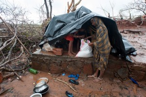 Four months down the road, many families still make their homes under government-issued tarps until they are able to rebuild their homes. (Image courtesy GFA)