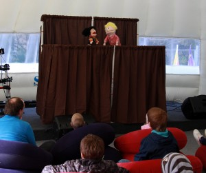 Ruth Mihalik helps with puppet show in the Fun Zone.