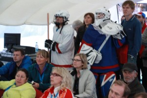Russian fans watching the USA vs Russia hockey game in the Fun Zone (photo by Greg Yoder).