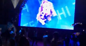 Flashmob at the concert. Singer on big screen. Flashmob in front. They kept cutting to the group during the concert.