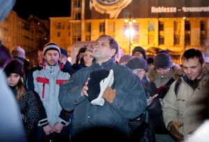 Pastor praying in Kiev in the midst of political revolution.  (Image courtesy EFCA ReachGlobal)
