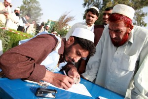 An Afghan worker verifies the identification card of a resident at a polling center in the Matun district of the Khost province of Afghanistan Sept. 18, 2010, during parliamentary elections.  (Image, caption courtesy U.S. Dept of Defense via Flickr)