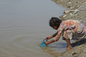 A little girl gathers water in rural India.  (Image courtesy India Partners via Facebook)
