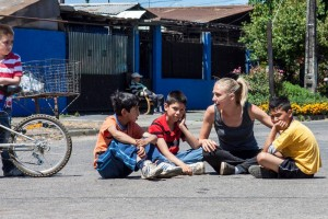 A team member of OM Chile's Adventure team 2012 sits down and talks with some little Chilean boys. (Image, caption courtesy OM)