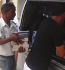Unloading Bibles.  (Image courtesy VBB)