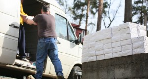 Workers unload Gospels of John for distribution.  (Image captured from screenshot of Russian Ministries' video)