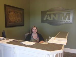 Jessica (summer intern) working at the front desk of Advancing Native Missions. (Photo, caption courtesy ANM)