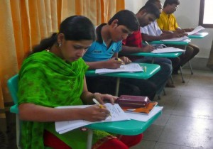 Students at Grace Bible College & Theological Seminary in Bangladesh take one of their daily exams.  (Image, caption courtesy FMI)
