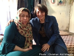 Norya (left) with a ministry worker. (Photo by Christian Aid Mission.