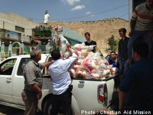 Ministry workers distribute aid to those who have been forced from their homes by ISIS. (Photo by Christian Aid Mission)