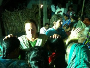 Team members pray for villagers in east India.  (Image courtesy India Partners)
