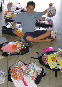 Go school shopping with your child, run your own drive, or give online. (Photo courtesy of Orphan Outreach)