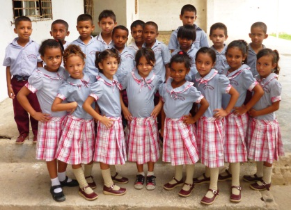 Uniforms bring a sewing center and school together to fight poverty