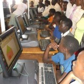 Many of these children had never touched a computer before the school opened the lab. (Image by AMG International).