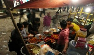 Streets come alive in Bangladesh as people gather to play games, socialize, and eat outdoors.  (Photo, caption courtesy FMI)