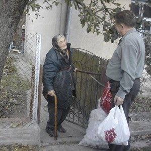 A pastor delivers items provided through SGA's Crisis Evangelism Fund.  (Photo cred: SGA)