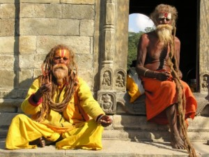 """So-called """"holy men"""" wait outside the entrance of the Hindu temple. Covered with human ashes, they smoke marijuana and have cow dung in their hair.  (Image courtesy VBB)"""