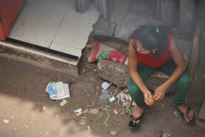A girl waits outside a brothel entrance. Conditions are filthy and sickness is rampant. Girls who succumb to infection are turned out on the streets to die. (Photo, caption courtesy VBB)