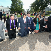 U.S. Sen. Ted Cruz of Texas (center, red tie) and ACLJ Executive Director Jordan Sekulow (right of Cruz) kneel in prayer outside of the White House on Sept. 26, 2013. Cruz and other national political and faith leaders joined with the ACLJ in calling for Pastor Saeed Abedini's release at prayer vigils marking the one-year anniversary of the pastor's imprisonment in Iran. (Photo courtesy of The American Center for Law and Justice)