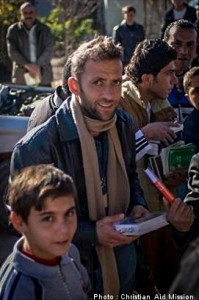 People of all religious backgrounds and ages are eager to receive Bibles in Kurdistan.  (Image, caption courtesy Christian Aid)