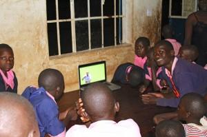 Deaf children in Nigeria watch the Ghanaian sign language Bible.  (Image, caption courtesy DOOR)