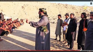 Sheik armed with knife & pistol teaches recruits in Islamic State boot camp.  (Screenshot of YouTube video courtesy Karl-Ludwig Poggemann via Flickr)