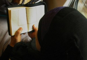 Muslim woman reading the Koran.  (Photo cred: Been Buddy Longway via Flickr)